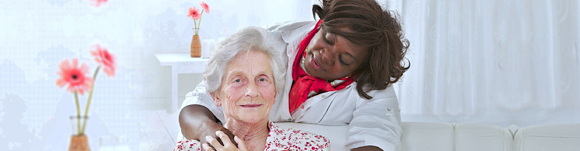 senior woman hugged by a caregiver