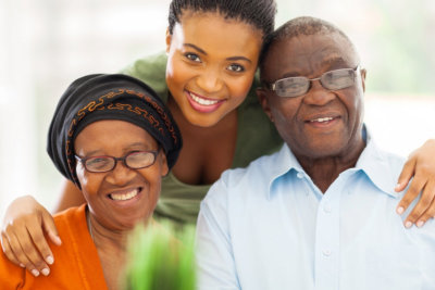 happy senior couple with their caregiver