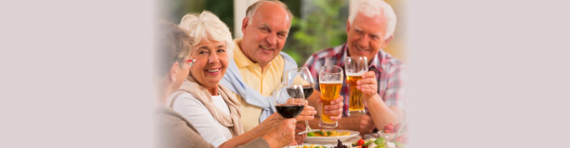 Happy senior friends drinking beer.